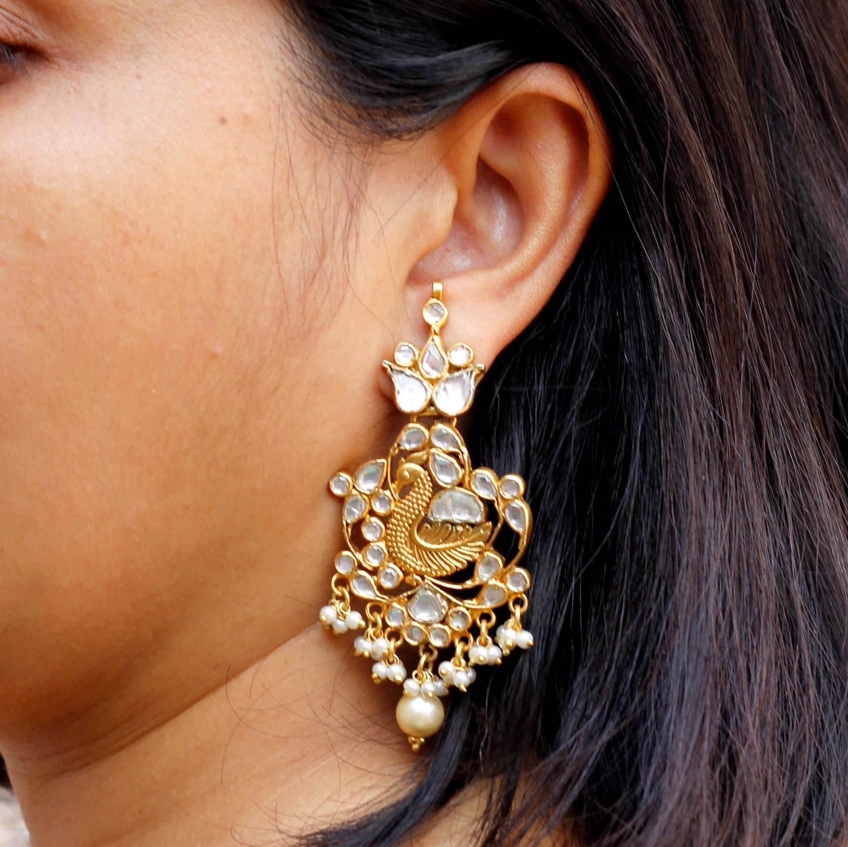 Peacock Kundan and pearl earring in silver with gold polish