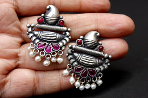 Temple style oxidised sterling silver earring with pearl and ruby