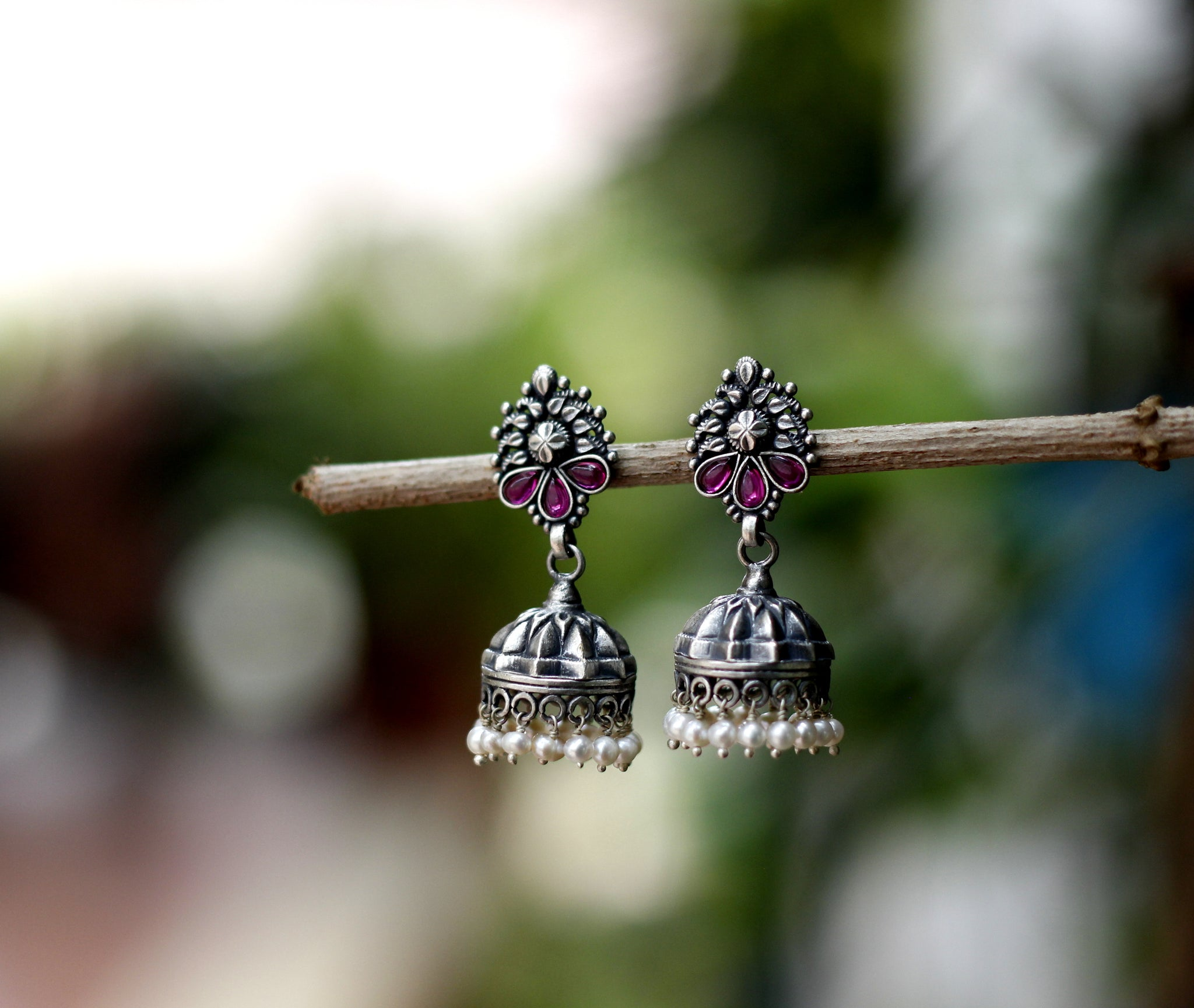 Sterling Silver temple jhumka in oxidized finish with pearl and ruby
