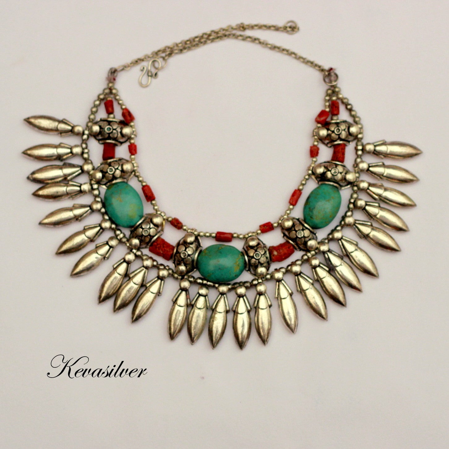 Coral and turquoise collar style necklace with metal spikes
