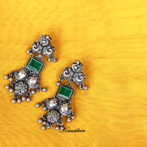 Temple style green earring