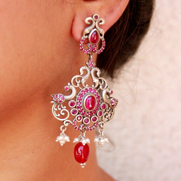 Ornate Silver earring with red stones