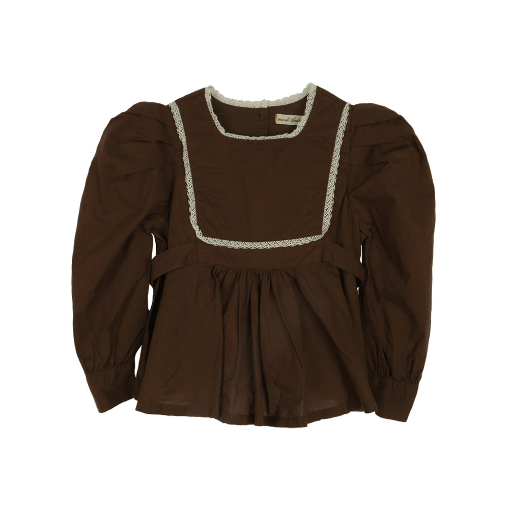 Raina blouse in brown. Brand: Amber Colour: Brown Details: Square neck, Lace, Ribbon at the back for slime fit, Puffy sleeves, Buttons at the back, Buttons at wrists Composition: 100% Cotton Made in: Korea