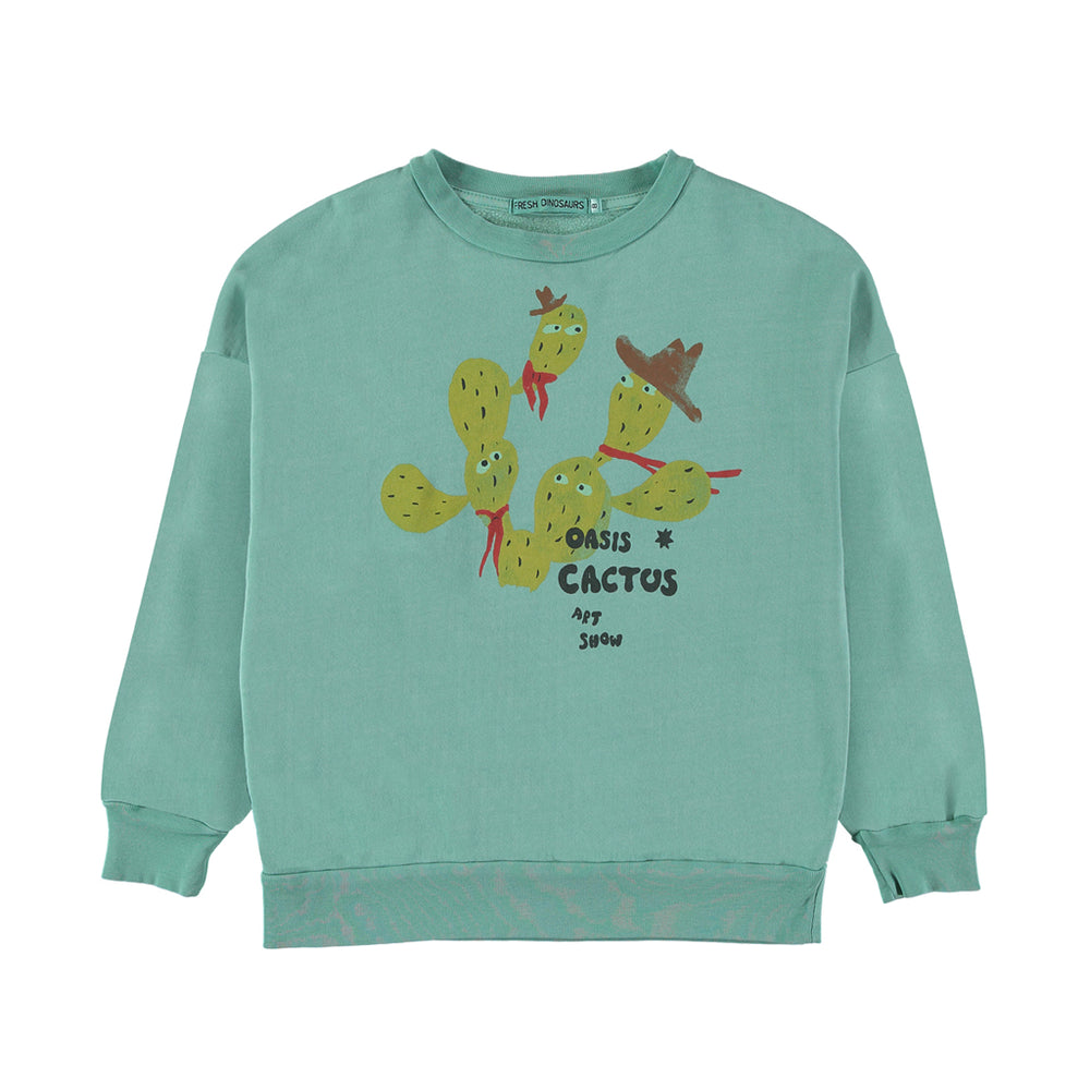 Brand: Fresh Dinosaurs Colour: Cremme de Menthe Details: Cactus print in yellow. Cactuses wear hats and neck scarves with a slogan 'Oasis cactus art show', Elastic waist, Soft touch, Round Neck, Long sleeves, Ribbed edges Composition: 100% Cotton Made in: Spain