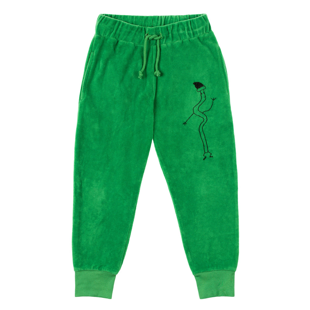 "Brand: Nadadelazos Colour: Broccoli Green Details: Unisex, Jogging pant with local print ""Spaguetti"",  Casing at waist with a cotton cord belt, Rib cuffs.  Composition: 100% organic cotton velour Made in: India Care: Machine wash 30 degree max, Do not dry clean, Do not tumble dry, Cold iron on the reverse side, Do not bleach."