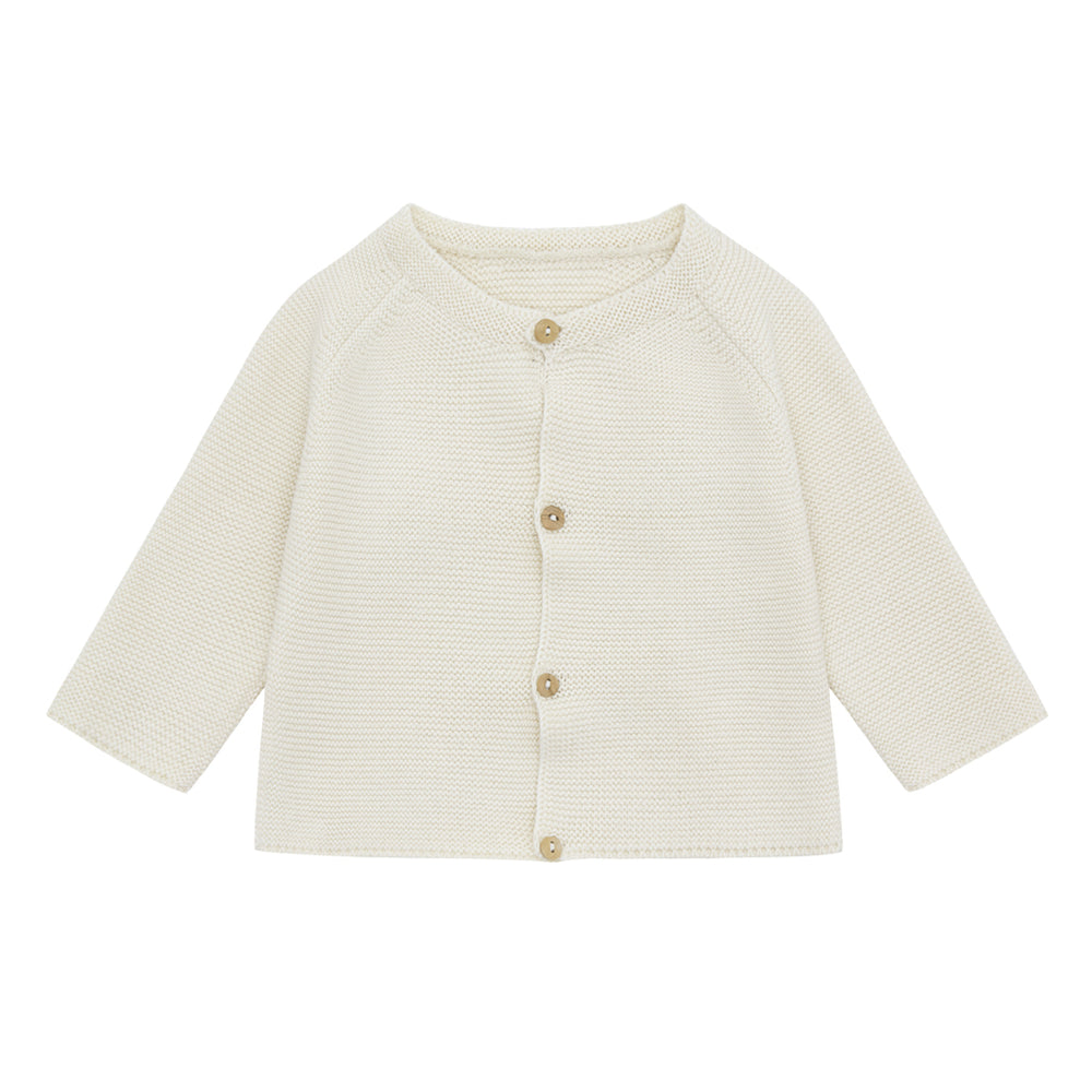 Brand: Vild  Colour: Ecru Details: Pure no-dye yarn of the highest quality, Incredibly soft, Eco-conscious, Round neck, Buttons at the front,   Composition: 100% Organic woven cotton  Made in: Portugal . comes in: ecru and palmetto colours.