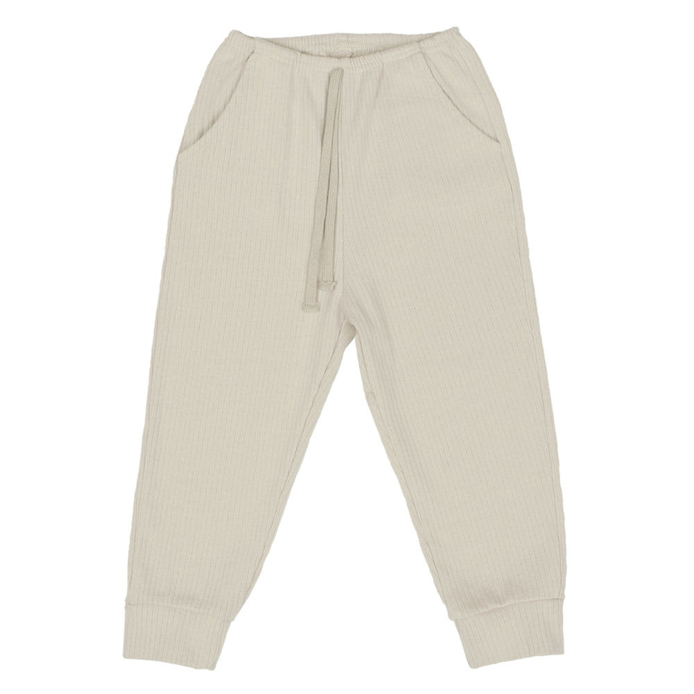 Myffy jogger pants comes in three colours: brown, cream and wine. Brand: Scon Details: Ribbed, Elastic waist, Slash pockets, Pocket at the back, Tightened at the ankles, Soft touch, Loose fit Composition: 95% Cotton, 5% Spandex Made in: Korea