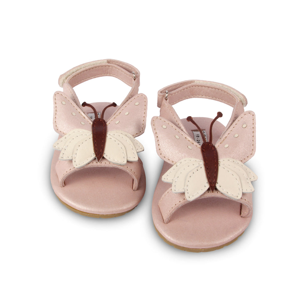 Brand: Donsje Colour: pastel pink. Details: Handmade & Fairtrade, Adjustable velcro fastening strap Anti slip suede outsole (size: 0-6 & 6-12 months),  Rubber flexible sole (size: 12-18 & 18-24 months) Composition:  100% Premium leather *** Donsje donates a part of its profits to the Shining Star foundation in Kenya.