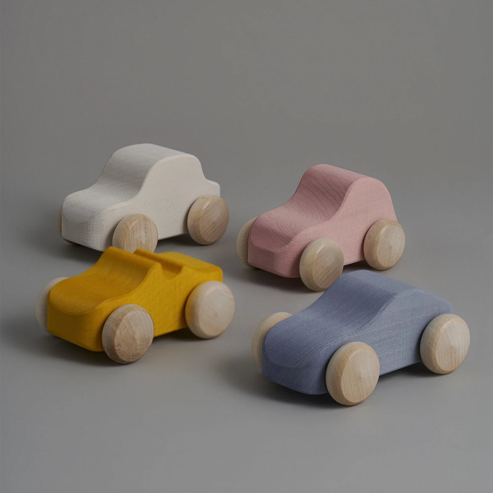 Toy cars in beige, silver and mustard colours. Brand: Raduga Grëz Composition: Lime wood  Made in: Russia The shades may differ from the shades on the screen. Tree-specific spots or streaks of wood are possible. Details and size may vary slightly as this is handmade.