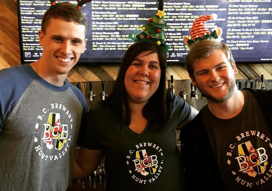 3 beertenders in BCB shirts and fun holiday headbands on their heads