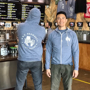 Dave on the left showing the back of the hoodie, Rich on the right showing the front.  The back has a full white BCB logo, the fron has a smaller logo on the breast.  Color is vintage denim blue, white zipper and hood string