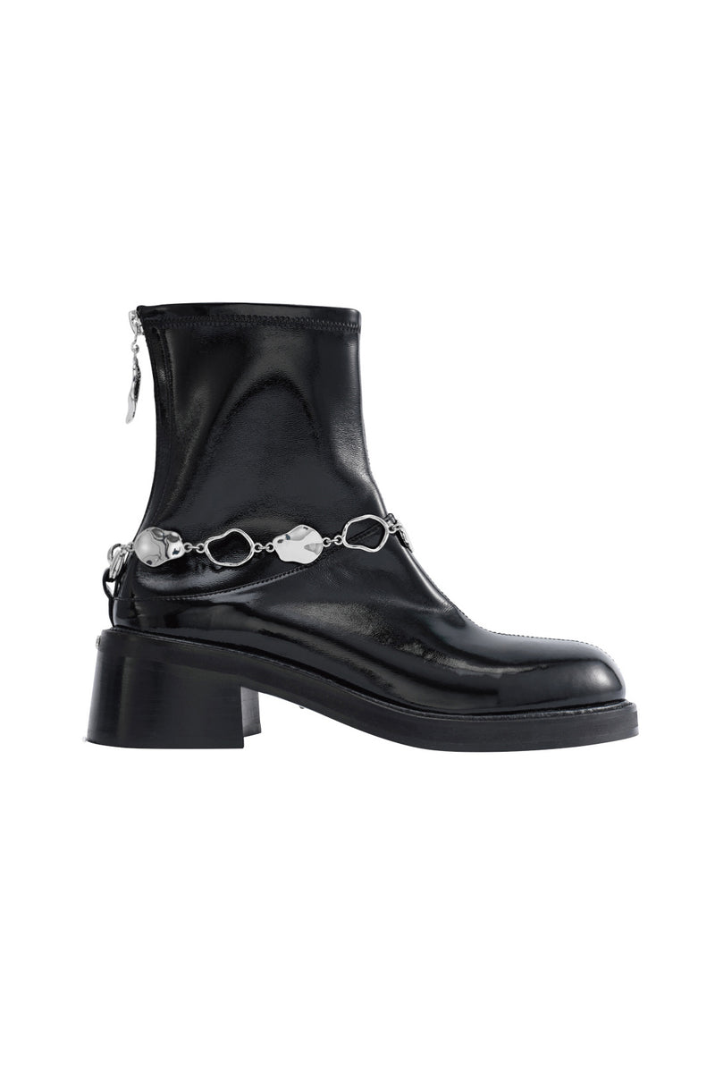Women's boots with patent leather surface and metal decoration