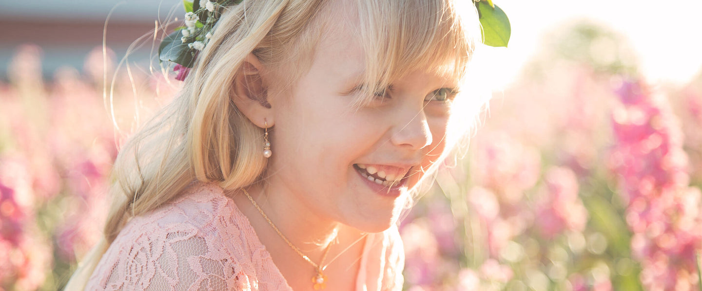 adorable flower girl in her Little Girl's Pearls jewelry for the wedding.