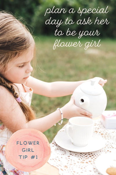 plan a special day to ask her to be your flower girl - photo of a little girl wearing pearls pouring tea.