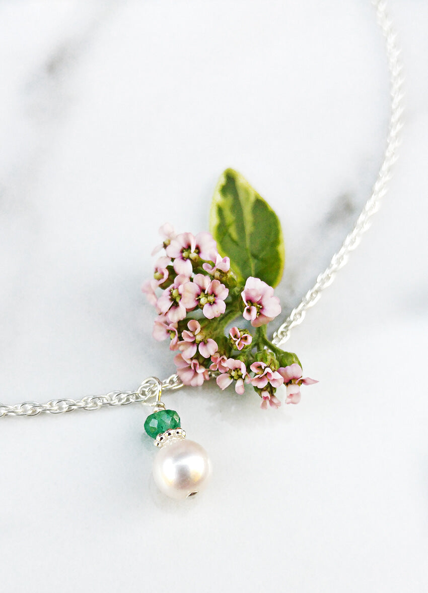 Emerald and Pearl Birthstone Necklace for May's birthstone.