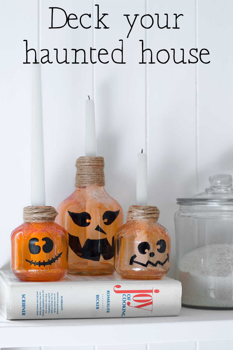 Deck your haunted house - pumpkin candle decorations.