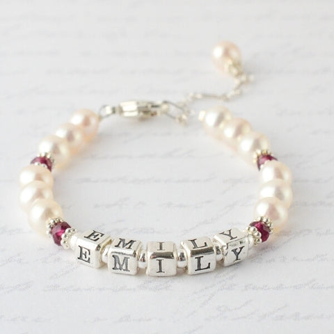 """Personalized pearl bracelet that says """"Emily"""" for First Communion"""