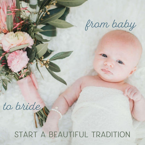 tiny baby wearing a pearl bracelet lying next to a wedding bouquet - from baby to bride, start a beautiful tradition.