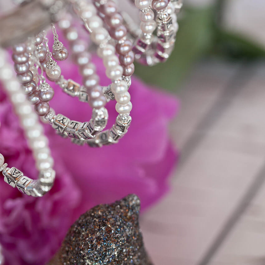 The meaning behind the pearl - the pearl over the centuries. | Name bracelets by Little Girl's Pearls