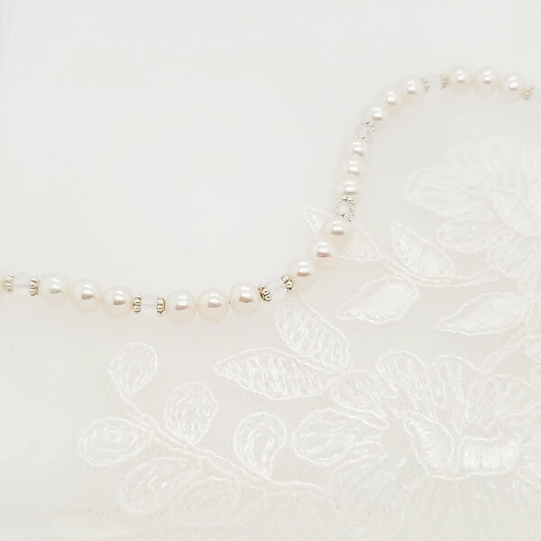April birthstone necklace with quartz, sterling silver, and pearls on lace.