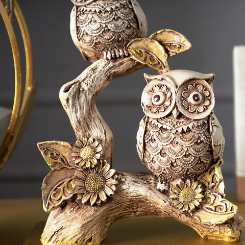 Rustic Owls Perched on a Branch