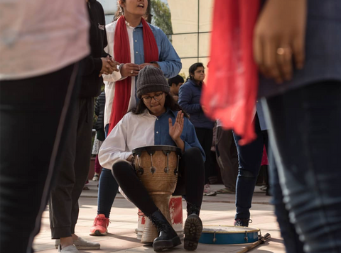 A snapshot of a girl performing street theatre