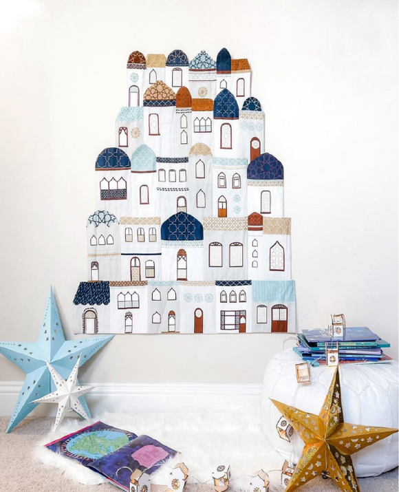 Fabric Ramadan calendar with mosques, shops and libraries