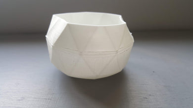 Geometric faceted polyhedron white candle holder made from fine bone china in organic finish