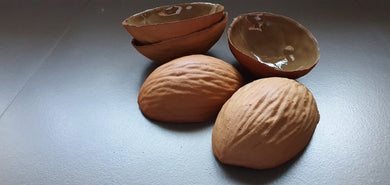 Big walnut shells in earthy woody colour in stoneware with clear glossy interior , ring dish - ring holder