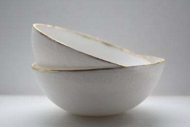 English fine bone china stoneware bowl with mat gold rims.