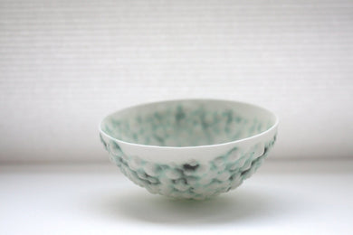 Stoneware bowl from English fine bone china with a unique textured surface and a hint of green