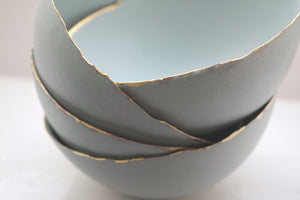 Blue porcelain bowl. Stoneware porcelain bowl in duck egg blue with gold rims.