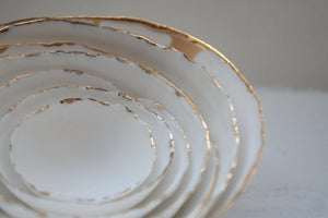 Set of 7 stoneware fine bone china nesting bowls with real gold.