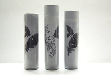 Bud vase made from gray earthenware with glossy effect and a butterfly on a feather