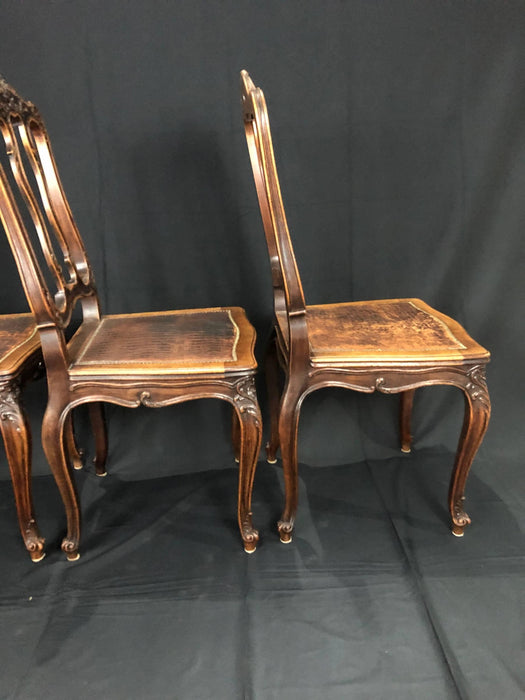 Set of Four French Louis XV Pressed Leather Carved Chairs