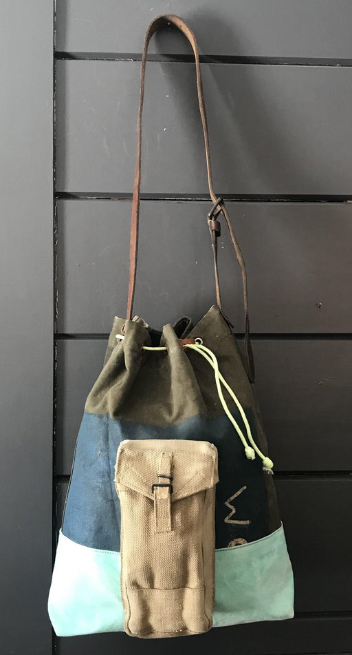 Vintage Painted Military Kit (vintage Painted Military Kit Bag, vintage turquoise tarpaulin bottom, vintage Military ammo pouch, Silver nylon lining, vintage tarpaulin pocket, glow in the dark drawstring, vintage suitcase Handle) for sale