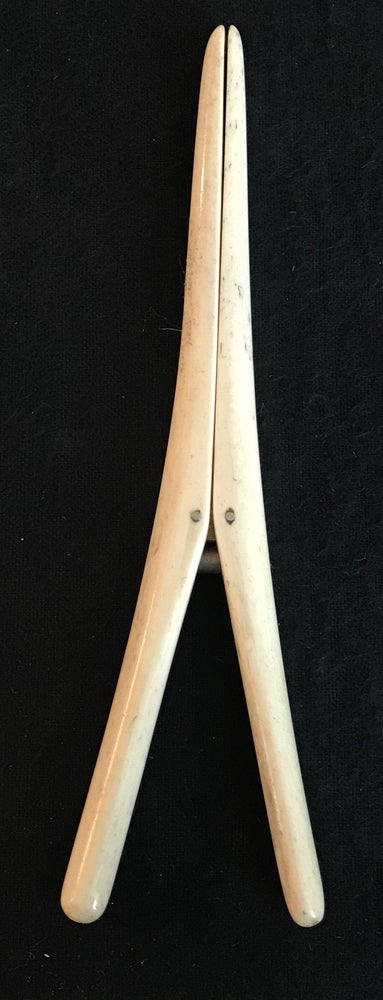 Antique spring action bone glove stretcher made in England for sale!