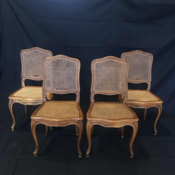 Set of Four French Walnut Carved Cane Dining Chairs