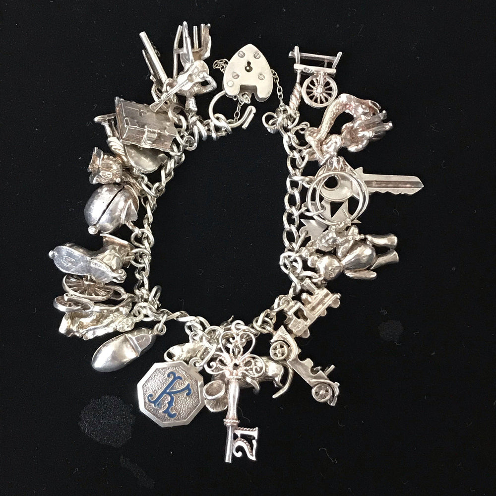British Silver Charm Bracelet (25 charms and lock) for sale