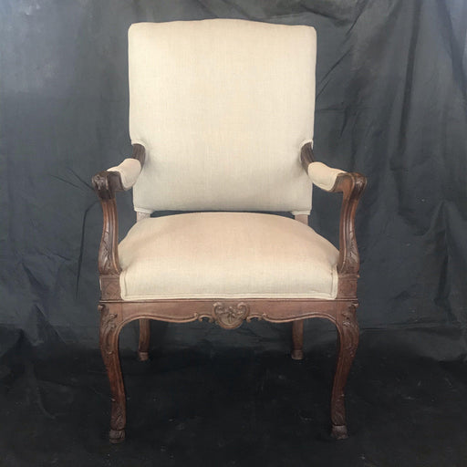 19th Century French Carved Regence Style Walnut Chair (Newly Upholstered) with Scrolled Arms and Hoof Feet
