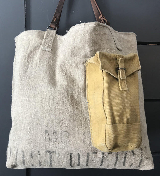 British Postal Canvas bag with Military Ammo Pack Outer Pocket, Silver Silk Viscose Interior lining, with a Belgian postal wallet interior pocket and leather handles buy this goegous purse