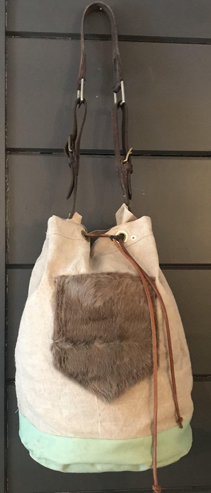 For sale: French Linen Duffle With a Fur Pocket and Belgian Postal Wallet and English Bridle Leather Straps