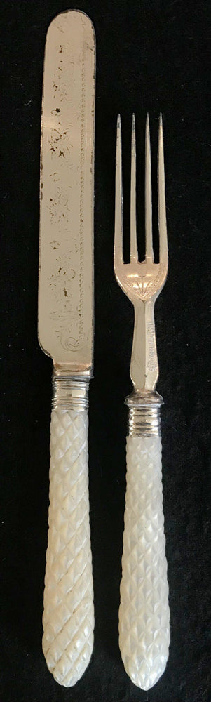 Early carved Mother of Pearl Fork/Knife set for sale