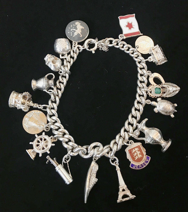 British Silver Charm Bracelet with 18 charms for sale