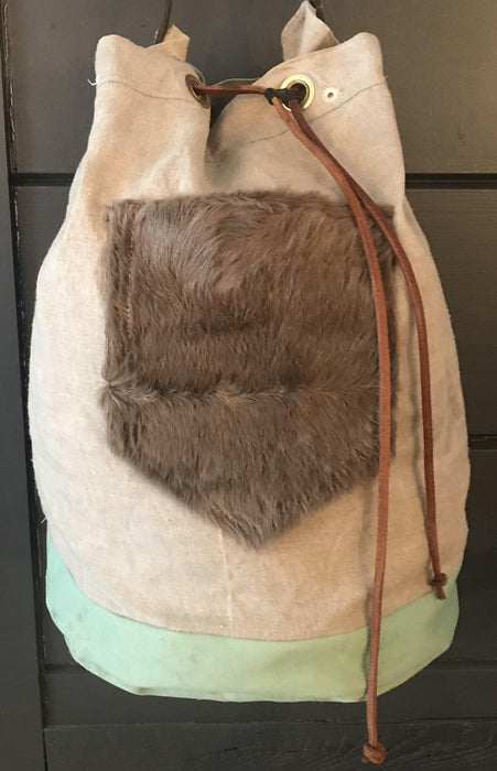French Linen Duffle With a Fur Pocket and Belgian Postal Wallet and English Bridle Leather Straps for sale