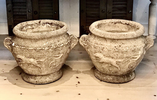 Pair of French Early 19th Century Neoclassical Stone Garden Urns with Roman Chariot Scenes