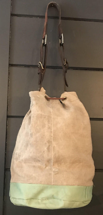 To buy: French Linen Duffle With a Fur Pocket and Belgian Postal Wallet and English Bridle Leather Straps