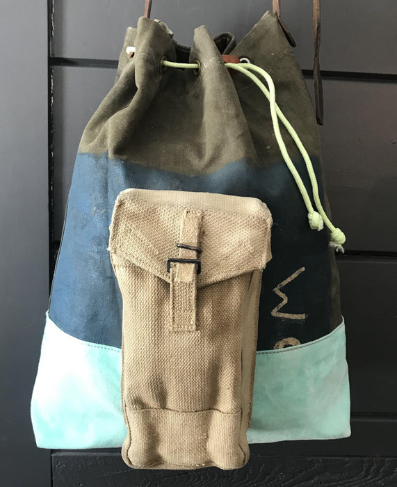 buy this Vintage Painted Military Kit (vintage Painted Military Kit Bag, vintage turquoise tarpaulin bottom, vintage Military ammo pouch, Silver nylon lining, vintage tarpaulin pocket, glow in the dark drawstring, vintage suitcase Handle)