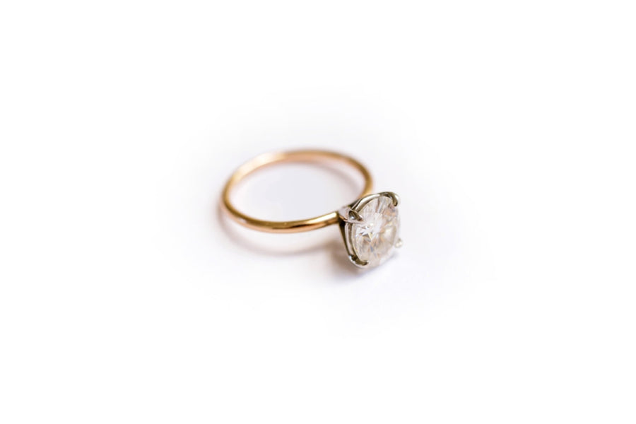 Ethical Oval Moissanite Engagement Ring with a Rose Gold Band