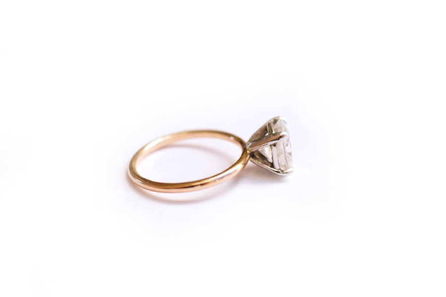 Oval Moissanite Engagement Ring with a Thin Rose Gold Band